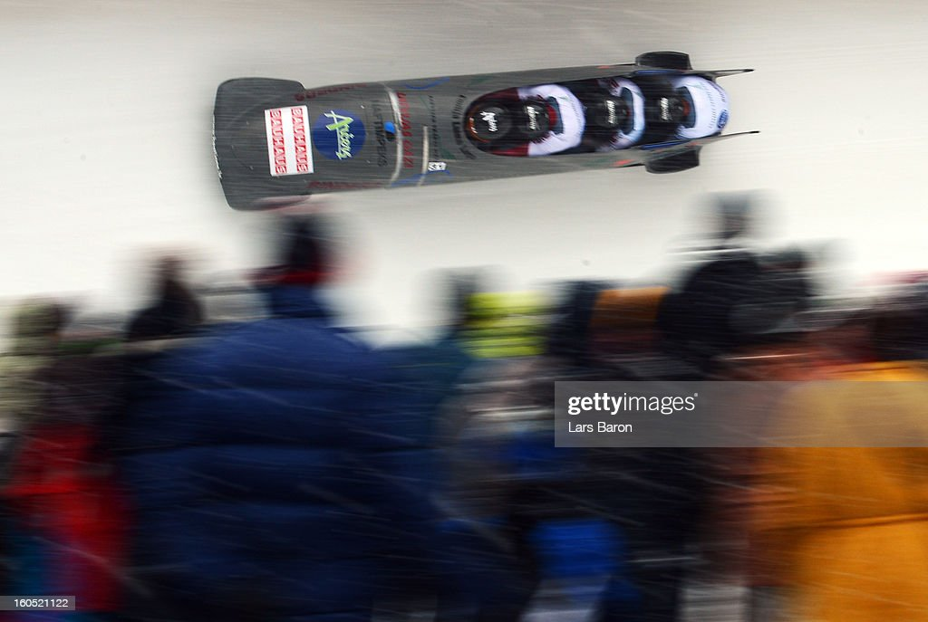 Oskars Melbardis, Daumants Dreiskens, Arvis Vilkaste and Intars Dambis of Latvia compete during the Four Men Bobsleigh heat two of the IBSF Bob & Skeleton World Championship at Olympia Bob Run on February 2, 2013 in St Moritz, Switzerland.