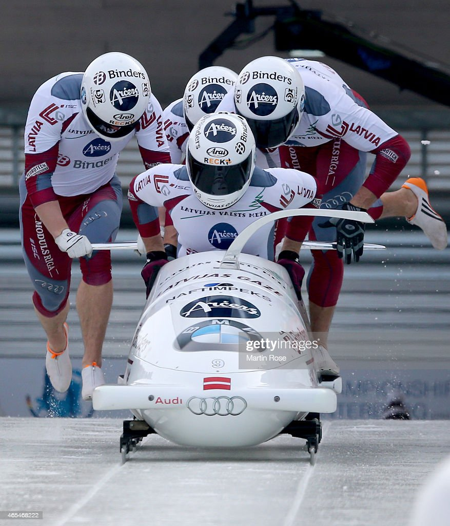 Oskars Melbardis Daumants Dreiskens Arvis Vilkaste and Janis Strenga of Latvia compete in their first run of the four man bob competition during the...