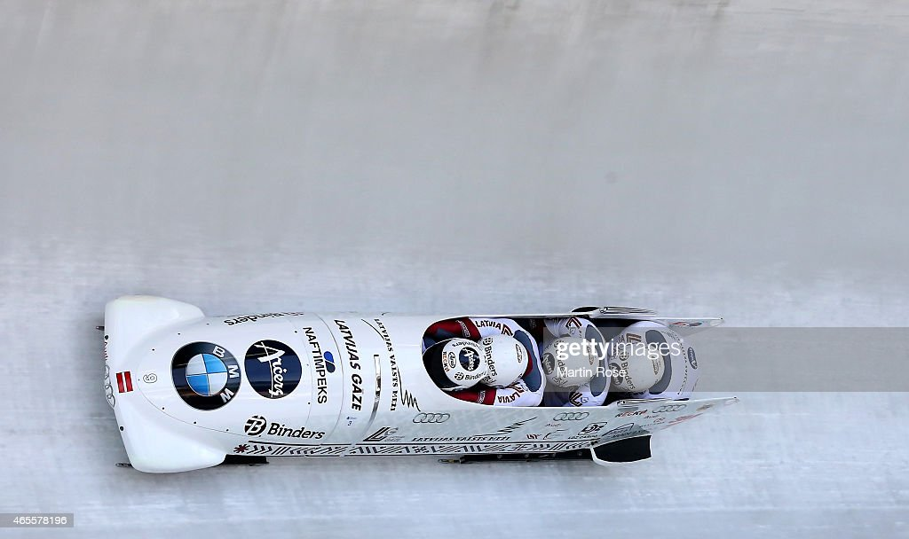 Oskars Melbardis Daumants Dreiskens Arvis Vilkaste and Janis Strenga of Latvia compete in their third run of the four man bob competition during the...