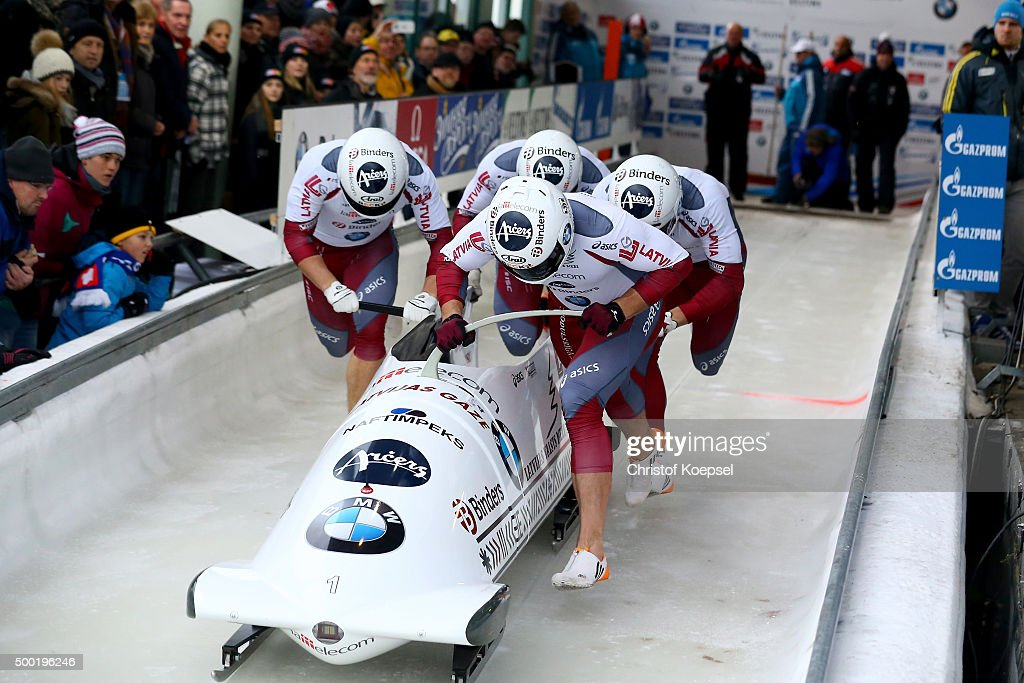 Oskars Melbardis Matiss Miknis Arvis Vilkaste and Janis Strenga of Latvia compete in their first run of the four men's bob competition during the BMW...