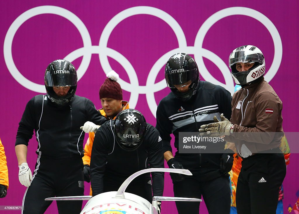 Oskars Melbardis of Latvia and his crew prepare to start during a fourman bobsleigh practice session on Day 14 of the Sochi 2014 Winter Olympics at...