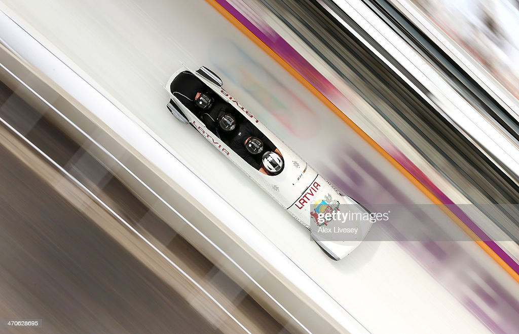 Oskars Melbardis of Latvia pilots a run during a fourman bobsleigh practice session on Day 13 of the Sochi 2014 Winter Olympics at Sliding Center...