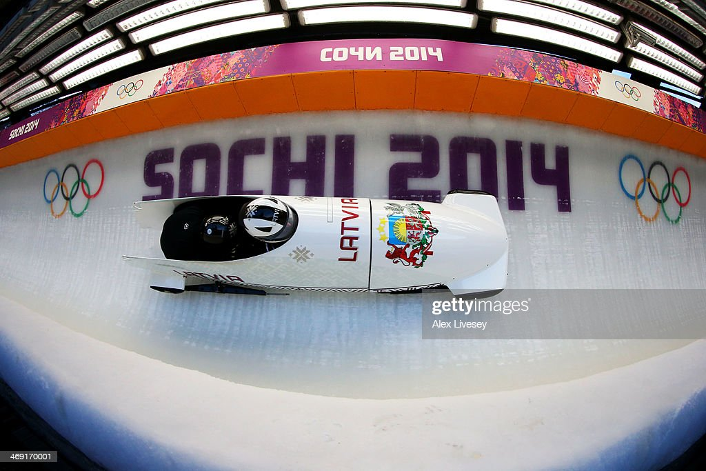 Oskars Melbardis of Latvia pilots a run during a Men's Twoman Bobsleigh training session on day 6 of the Sochi 2014 Winter Olympics at the Sanki...