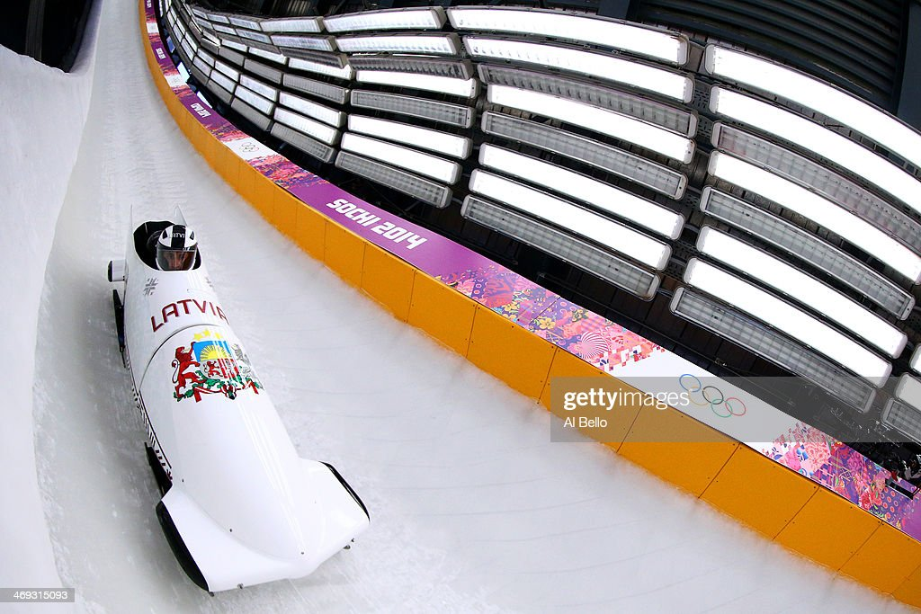 Oskars Melbardis of Latvia pilots a run during a Men's TwoMan Bobsleigh training session on day 7 of the Sochi 2014 Winter Olympics at the Sanki...