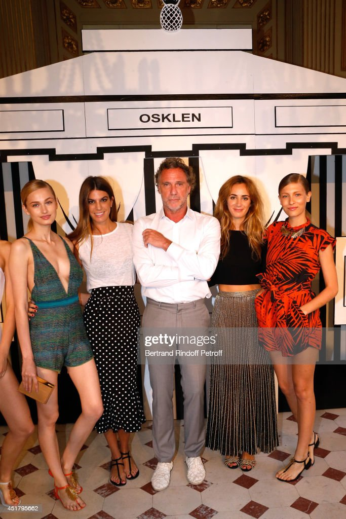Osklen Praia CIO Oskar Metsavaht standing between Fashion designers Bianca Brandolini D'adda (3rd L), <a gi-track='captionPersonalityLinkClicked' href=/galleries/search?phrase=Alexia+Niedzielski&family=editorial&specificpeople=4865022 ng-click='$event.stopPropagation()'>Alexia Niedzielski</a> (2nd R) and models attend the Osklen Praia show as part of Paris Fashion Week - Haute Couture Fall/Winter 2014-2015. Held at Brasil Albassy on July 7, 2014 in Paris, France.