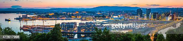 Oslo harbour waterfront landmarks panorama illuminated at summer sunset Norway
