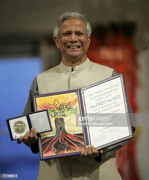EDS NOTE CORRECTING BYLINE IN CAPTIO Nobel Peace laureate Muhammad Yunus poses for a picture with the Nobel medal and diploma at Oslo Town Hall 10...