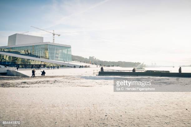 Oslo Opera House is photographed for Madame Figaro on January 21 2017 in Oslo Norway Contruction site of the new Munch museum is seen in the...