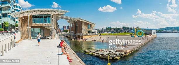 Oslo summer in city people relaxing at Aker Brygge Norway