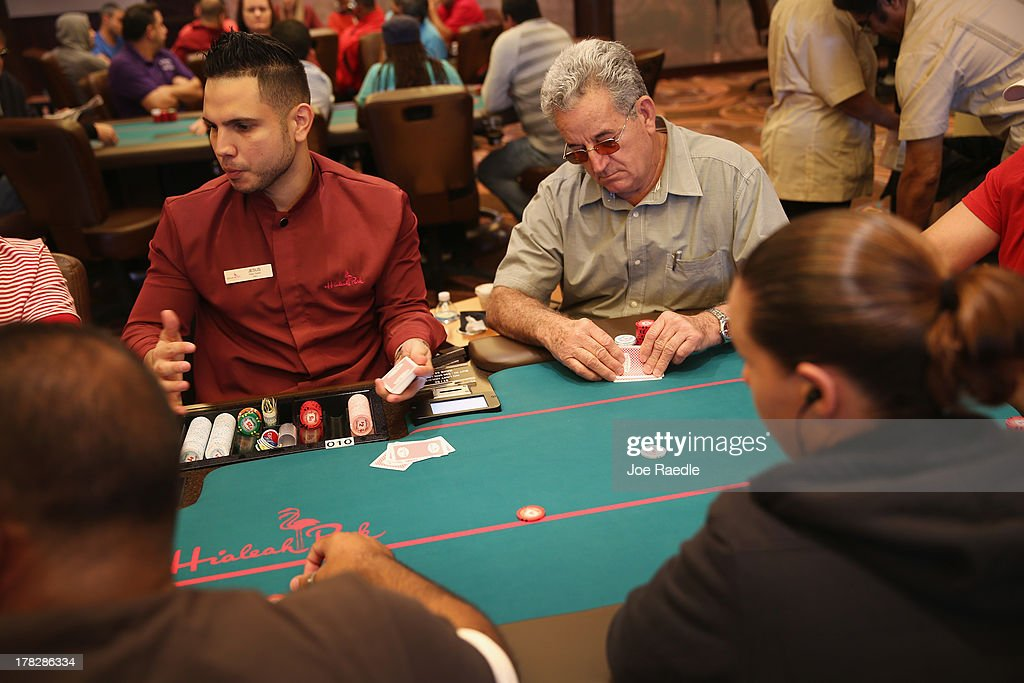 Oslvado Morales checks his cards at the Blackjack table as he plays in the casino that will hold its grand opening on Friday located in the Hialeah Park Race Track which first opened in 1925 on August 28, 2013 in Hialeah, Florida. The new casino is located in the same complex as the race track which in its heyday was known as the 'the worlds most beautiful race course.'