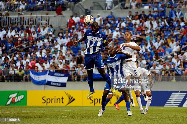 Osman Chavez of Honduras heads the ball as Nery Medina battles with Alvaro Saborio of Costa Rica in the first half during the 2013 CONCACAF Gold Cup...