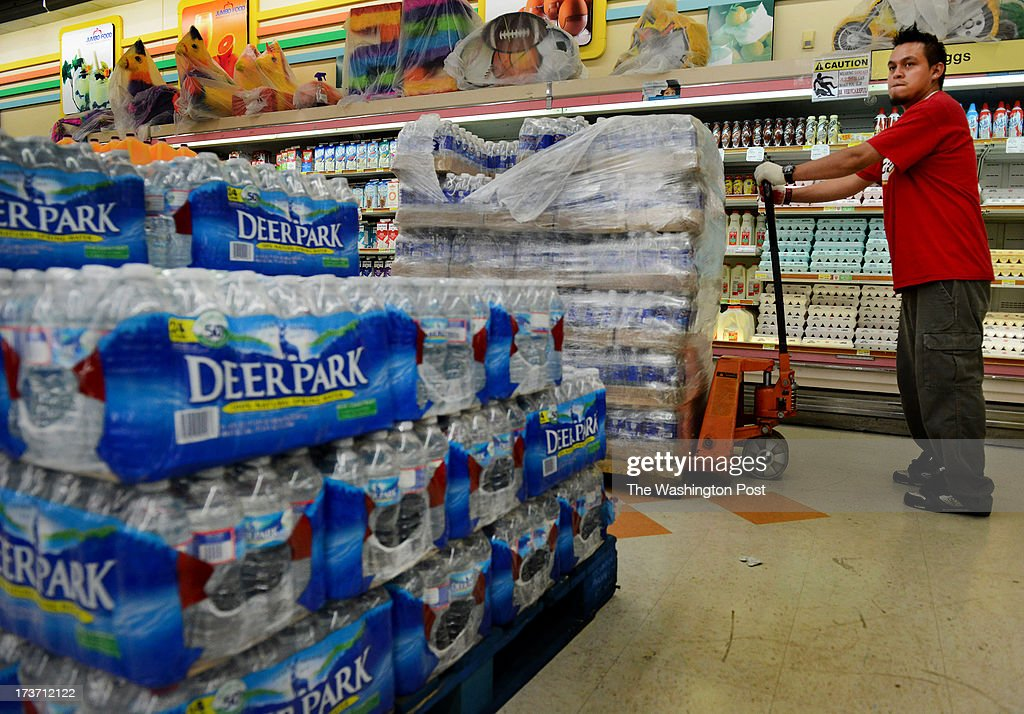 Osman Raul restocks drinking water at Jumbo Foods International Supermarket in Temple Hills, MD on July 16, 2013. The supermarket is well stocked for water because the manager had warehoused water, along with other emergency supplies in preparation for the summer storm season. Later today the Washington Suburban Sanitary Commission will shut down a water main that will cut water to thousands of residents and businesses in southern Prince George's County. The shutoff is necessary to make much-need repairs. WSSC officials say the outage will run 2-4 days WSSC officials say. They're advising residents to stock up on water, fill bathtubs to use for flushing, and ration water as much as necessary.