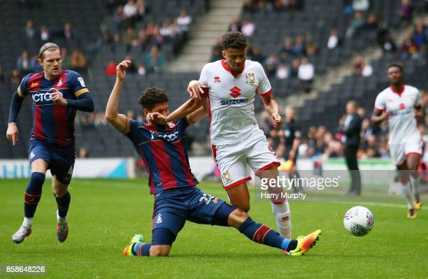 Osman Sow of Milton Keynes Dons is challenged by Nathaniel KnightPercival of Bradford City during the Sky Bet League One match between Milton Keynes...