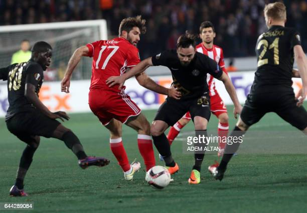 Osmanlispor's Musa Cagiran fights for the ball with Olympiacos' Karim Ansarifard during the UEFA Europa League round of 32 second leg soccer match...