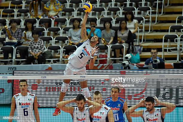 Osmany Juantorena of Italy serves the ball agaibst Iran during the FIVB Men's Volleyball World Cup Japan 2015 at the Osaka Municipal Central...