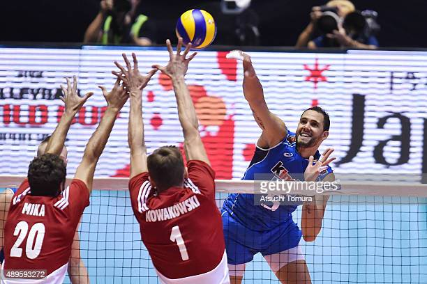 Osmany Juantorena of Italy spikes the ball in the match between Italy and Poland during the FIVB Men's Volleyball World Cup Japan 2015 at Yoyogi...