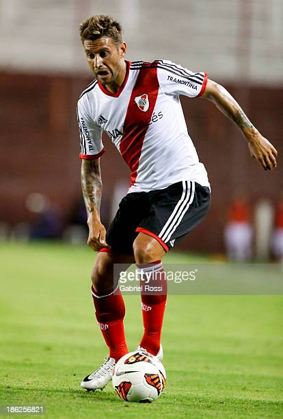 Osmar Ferreyra of River Plate drives the ball during a match between Lanus and River Plate as part of Copa Total Sudamericana at Ciudad de Lanus...