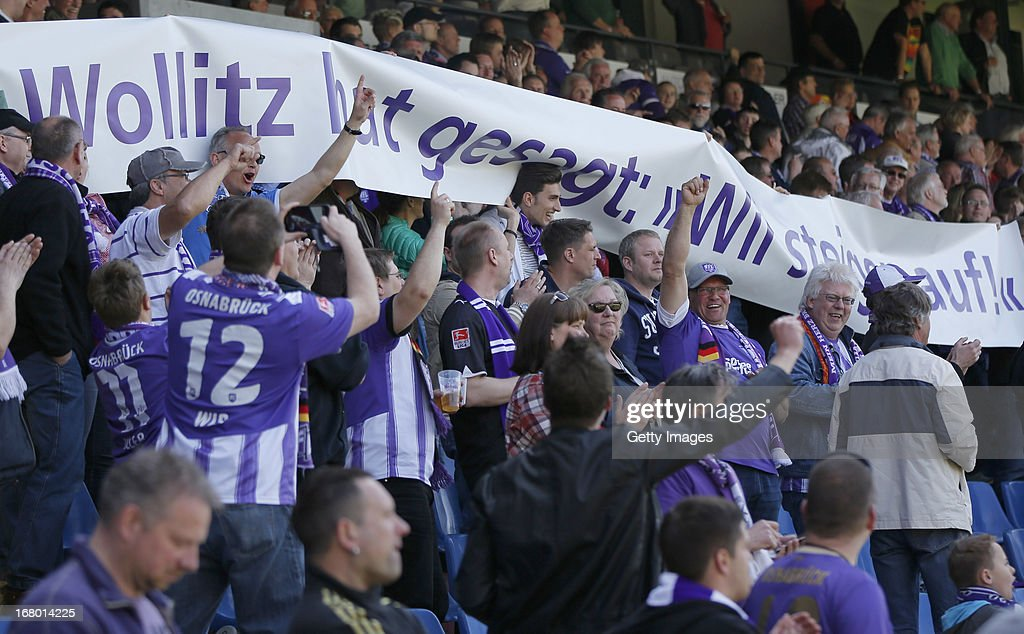 Osnabrueck's supporters hold a banner reading 'Wollitz hat gesagt, wir steigen auf!' during the Third League match between VfL Osnabrueck and Wacker Burghausen at Osnatel Arena on May 4, 2013 in Osnabruck, Germany.