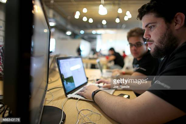 Osniel Gonzalez and Jose Pimienta work on a project they are calling Cuba Direct during the Hackathon for Cuba event on February 1 2014 in Miami...