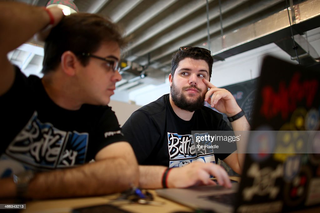 Osniel Gonzalez (L) and Jose Pimienta work on a project they are calling Cuba Direct during the Hackathon for Cuba event on February 1, 2014 in Miami, Florida. The hackathon brought together experts and programmers to devise innovative technology solutions aimed at strengthening communications and information access in Cuba. The event is organized by Roots of Hope with support from the John S. and James L. Knight Foundation.