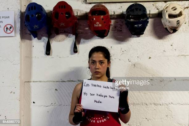 Osorno Chile 24 January 2017 The amateur boxer Macarena Vásquez 14 years old and belonging to the Boxing School Ta Mi Chau poses with a sign that...