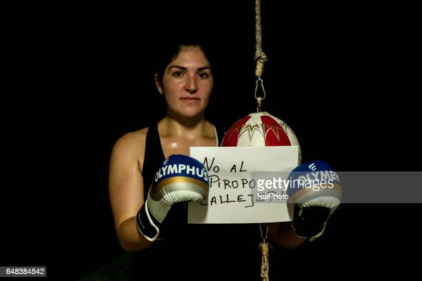 Osorno Chile The amateur boxer Erla Hernández 32 years old and belonging to the Boxing School Ta Mi Chau poses with a sign that says No more...