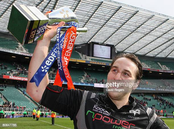 Ospreys captain Ryan Jones lifts the trophy following his team's victory during the EDF Energy Cup Final between Leicester Tigers and the Ospreys at...