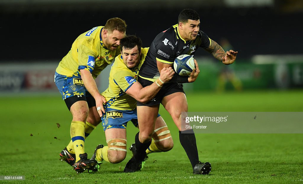 Ospreys centre Josh Matavesi escapes the clutches of Fritz Lee (l) and Loic Jacquet of Clermont during the European Rugby Champions Cup Pool 2 match between Ospreys v ASM Clermont Auvergne at Liberty Stadium on January 15, 2016 in Swansea, Wales.