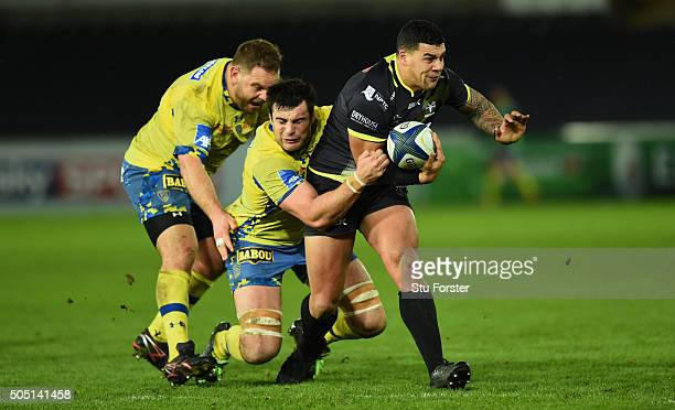 Ospreys centre Josh Matavesi escapes the clutches of Fritz Lee and Loic Jacquet of Clermont during the European Rugby Champions Cup Pool 2 match...