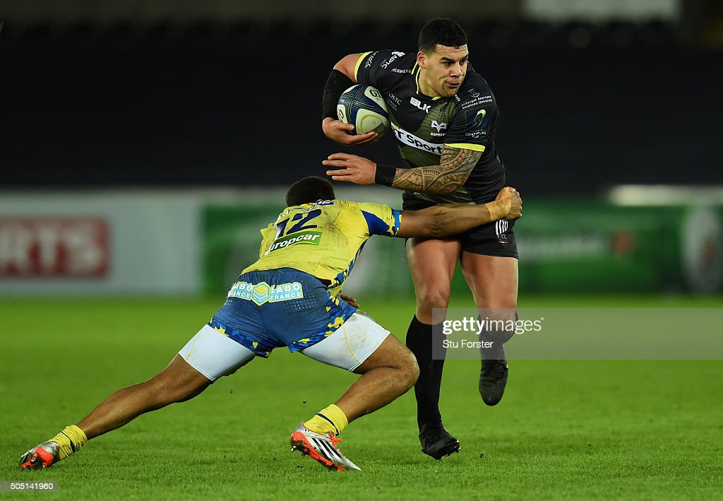 Ospreys centre Josh Matavesi is tackled by Wesley Fofana of Clermont during the European Rugby Champions Cup Pool 2 match between Ospreys v ASM Clermont Auvergne at Liberty Stadium on January 15, 2016 in Swansea, Wales.