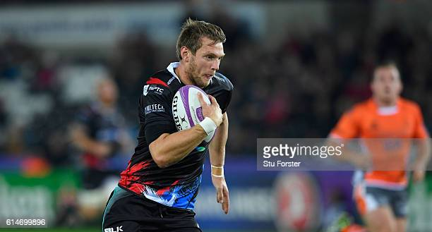 Ospreys fly half Dan Biggar races through for the opening try during the European Rugby Challenge Cup match Ospreys and Newcastle Falcons at The...