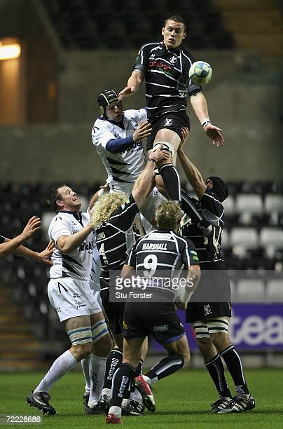 Ospreys forward Ian Evans wins a line out ball during the Heineken Cup Pool Match between the Ospreys and Sale Sharks on October 20 2006 in Swansea...