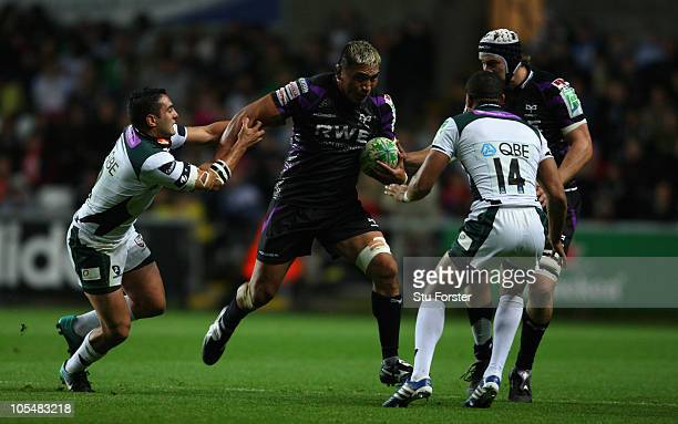 Ospreys forward Jerry Collins runs through the challenge of Irish centre Daniel Bowden during the Heineken Cup Pool 3 match between Ospreys and...