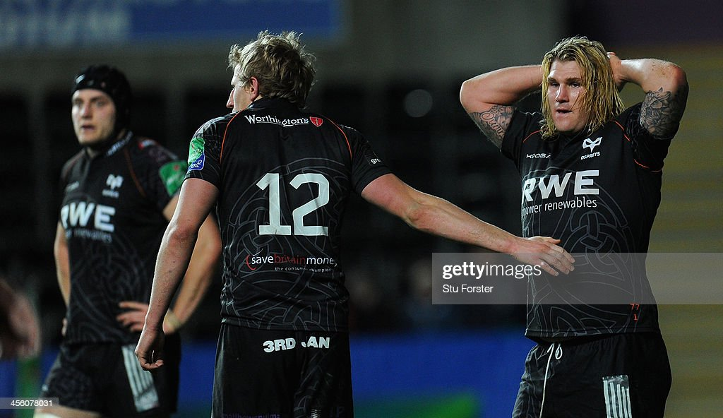 Ospreys hooker <a gi-track='captionPersonalityLinkClicked' href=/galleries/search?phrase=Richard+Hibbard&family=editorial&specificpeople=4313527 ng-click='$event.stopPropagation()'>Richard Hibbard</a> (r) reacts during the Heineken Cup pool 1 round 4 match between Ospreys and Castres Olympique at Liberty Stadium on December 13, 2013 in Swansea, Wales.