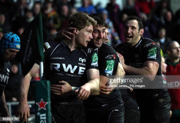 Ospreys' Jonathan Spratt Scott Baldwin and Joe Bearman during the Heineken Cup Pool Two match at The Liberty Stadium Swansea