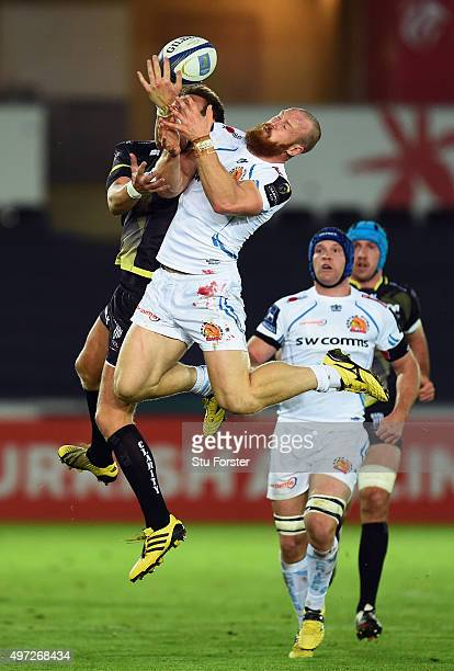 Ospreys player Dan Biggar challenges a high ball with James Short of the Chiefs during the European Rugby Champions Cup Pool 2 round 1 match between...