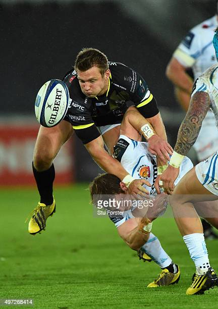 Ospreys player Dan Biggar challenges a high ball with Will Chudley of the Chiefs during the European Rugby Champions Cup Pool 2 round 1 match between...