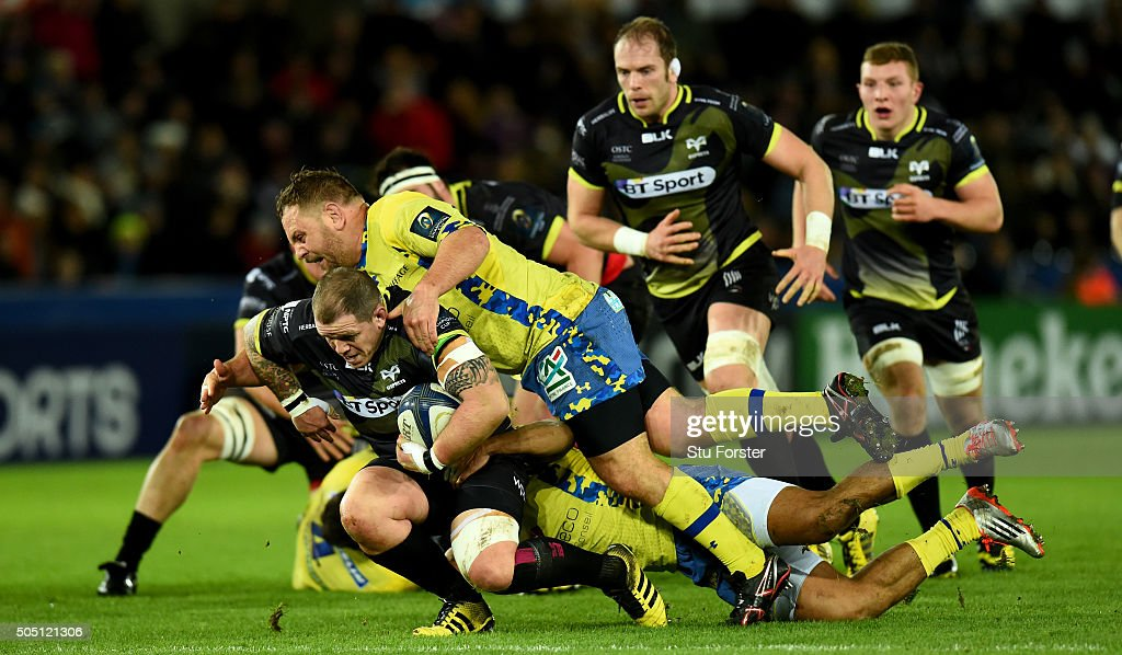 Ospreys prop Paul James is stopped in his tracks by Daniel Kotze of Clermont during the European Rugby Champions Cup Pool 2 match between Ospreys v ASM Clermont Auvergne at Liberty Stadium on January 15, 2016 in Swansea, Wales.
