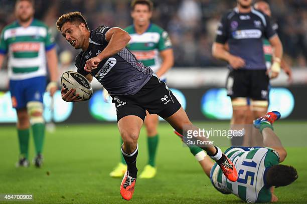 Ospreys scrum half Rhys Wwebb makes a break to score the second try during the Guinness Pro 12 match between Ospreys and Benetton Rugby Treviso at...