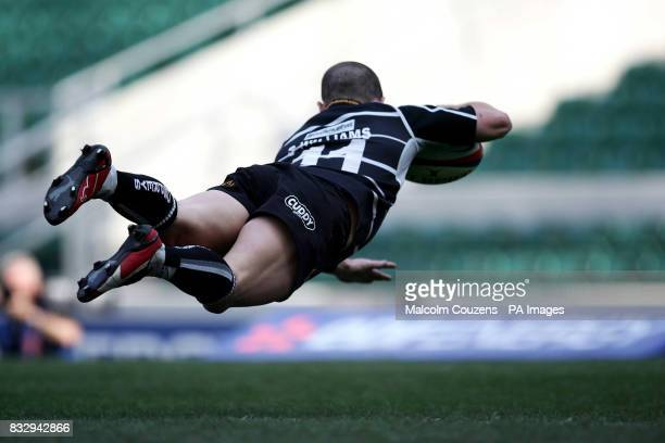 Ospreys' Shane Williams dives over for his first try during the EDF Energy Cup Final match at Twickenham London