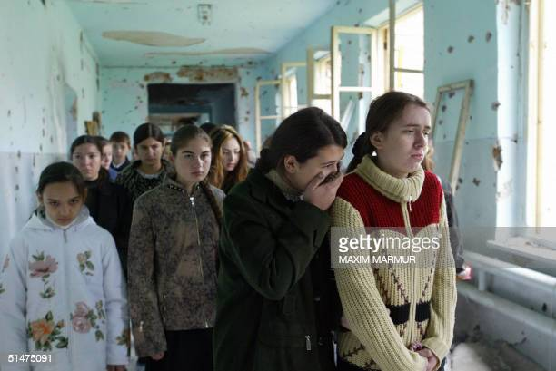 Ossetian girls cry as they walk in school No1 in Beslan 13 October 2004 This week marks the end of the traditional 40 day mourning period since the...
