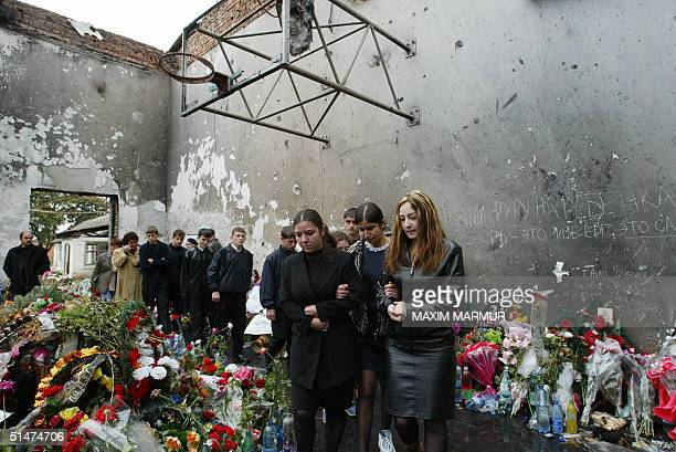 Ossetians mourn at the destroyed school's gymnasium in Beslan 13 October 2004 This week marks the end of the traditional 40 day mourning period since...