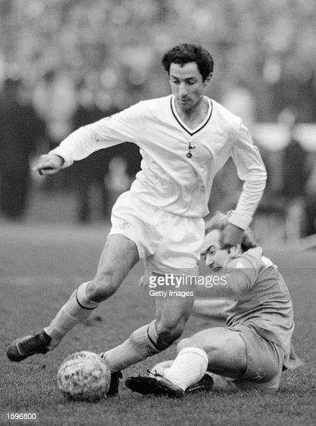 Ossie Ardiles of Tottenham Hotspur takes the ball past Clive Walker of Chelsea during the FA Cup Quarter Final held on March 6 1982 at Stamford...