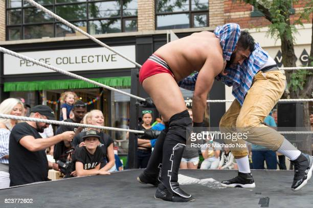 Ossington Festival or Ossfest 'Superkicked' professional wrestling performs to the delight of the crowd attending the little cozy street celebration
