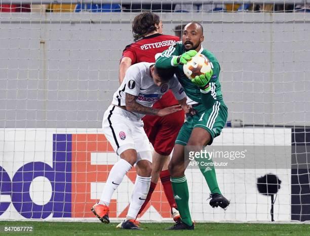 Ostersund goalkeeper Aly Keita vies with Zorya midfielder Artem Gromov during during the UEFA Europa League Group J football match between Zorya...