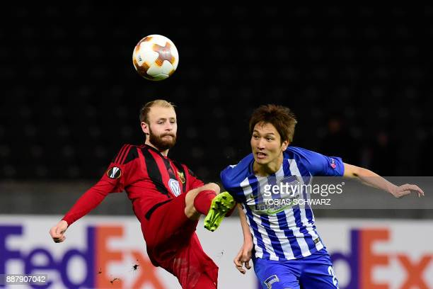 Ostersund's Curtis Edwards and Berlin's Japanese midfielder Genki Haraguchi vie for the ball during the UEFA Europa League group J football match...