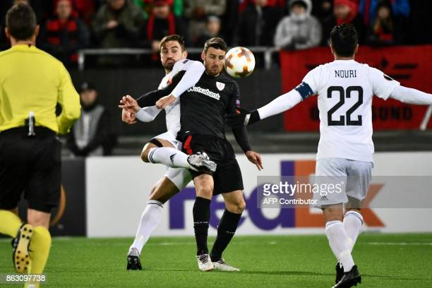 Ostersunds' defender from Sweden Sotirios Papagiannopoulos and Athletic Bilbao's Spanish forward Aritz Aduriz vie for the ball during the UEFA Europa...
