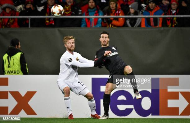 Ostersund's Dennis Widgren and Athletic Bilbao's Spanish forward Aritz Aduriz vie for the ball during the UEFA Europa League group F fotball match...