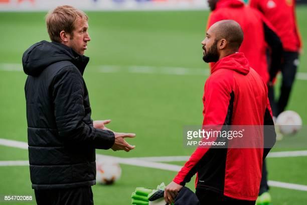 Ostersunds FK coach Graham Potter talks to goalkeeper Aly Keita during a training session at Jamtkraft Arena in Ostersund Sweden on September 27 on...