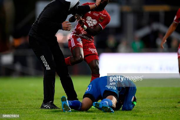 Ostersund's goalkeeper Aly Keita remains on the ground after a masked soccer spectator attacked him during a football match between Jonkoping Sodra...